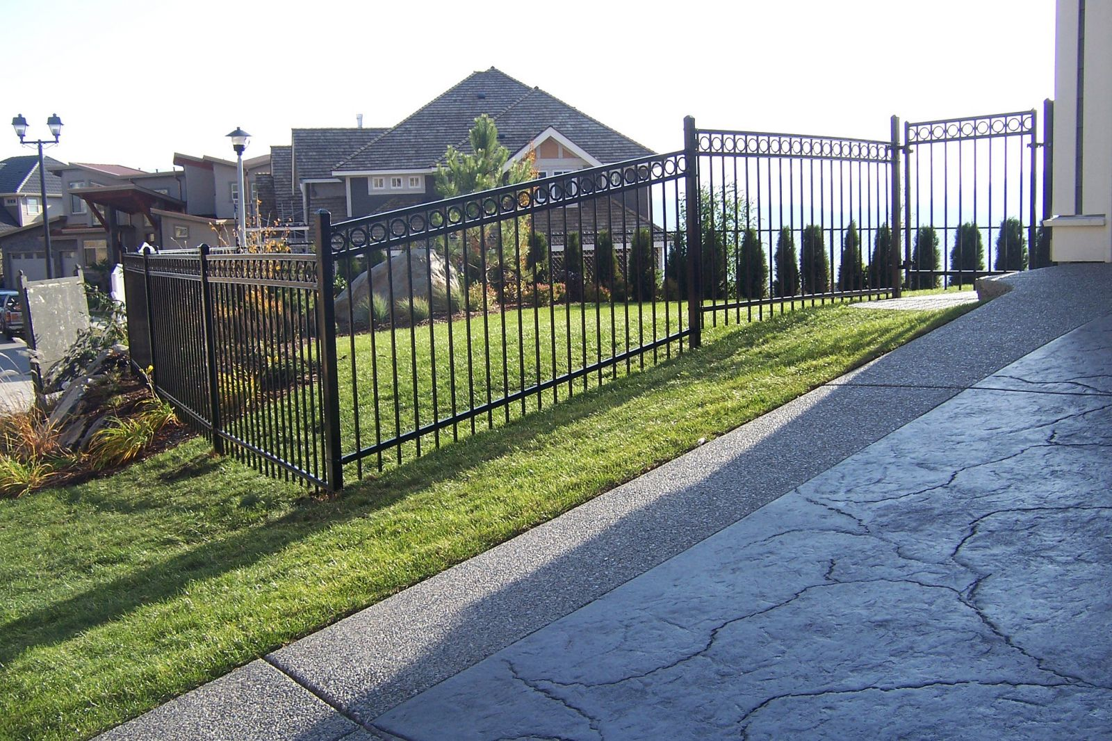 Ornamental iron fence around a yard in the Fraser Valley