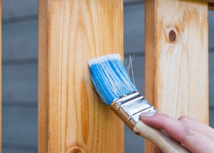 What are the benefits of buying pre-stained wood fencing?